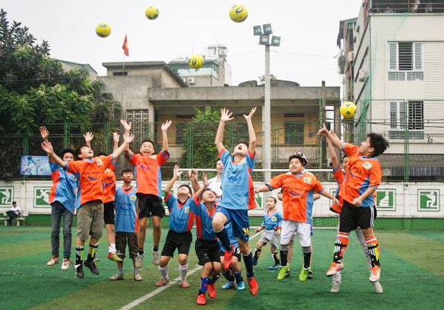 Children at Not For Sale's Vietnam project play soccer.