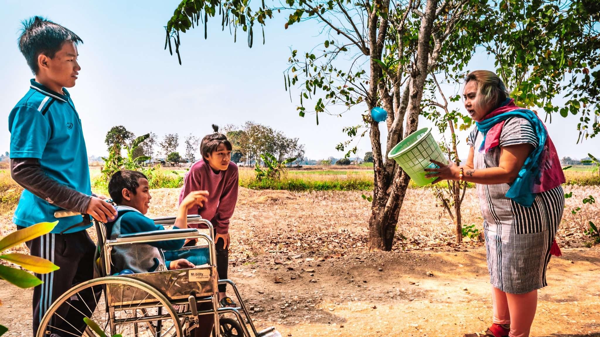 Krunam playing ball games with three children in Thailand